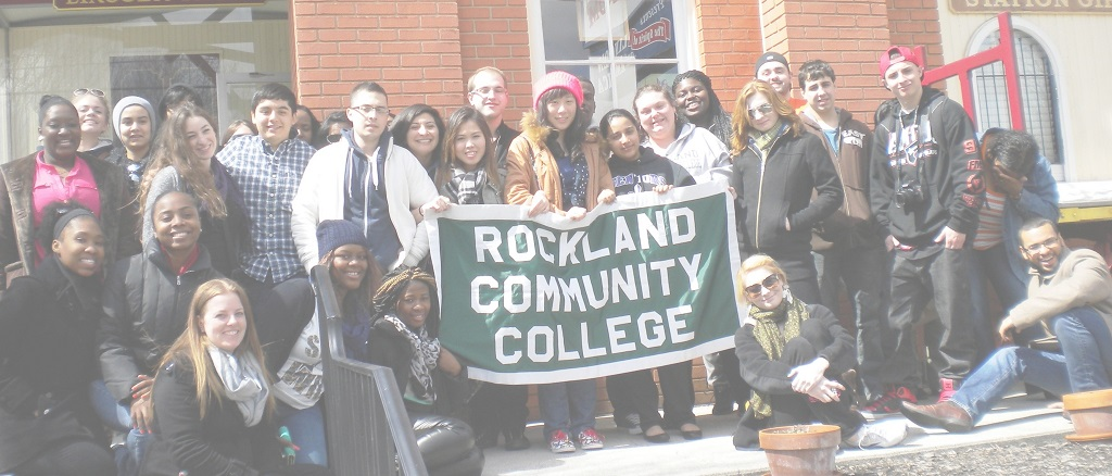 group of students holding a Rockland Community College banner