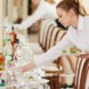 server placing dishes on table